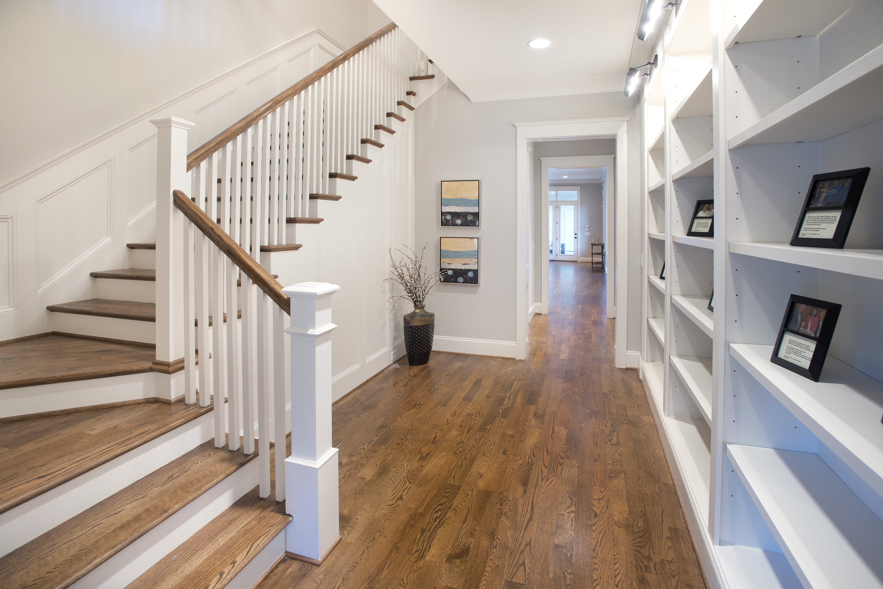 built in shelving and wood floors
